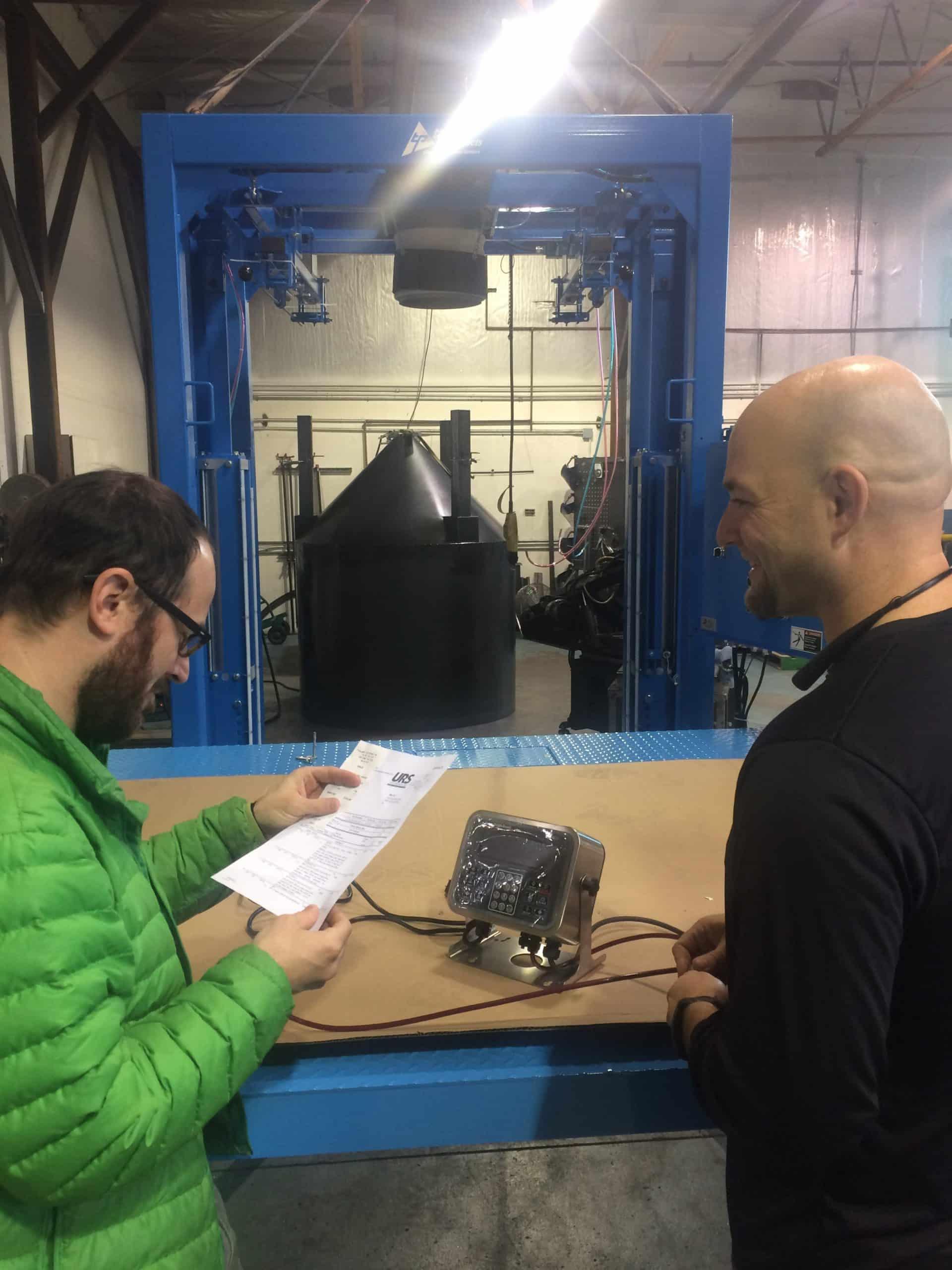 Technicians discussing programming an NTEP Bulk Bag Filler